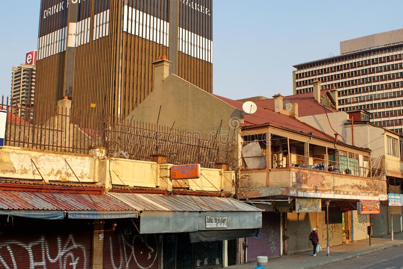 Small businesses below high rises in Johannesburg stock photography