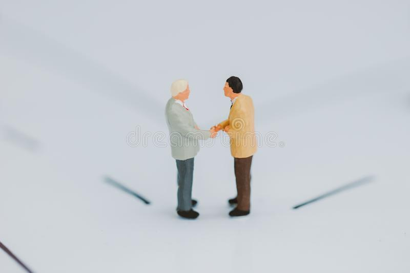 Businessmen checking hand. royalty free stock image
