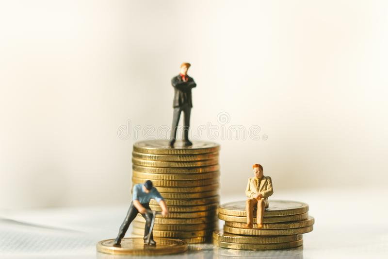 Businessman figures standing. money saving. Investment royalty free stock image
