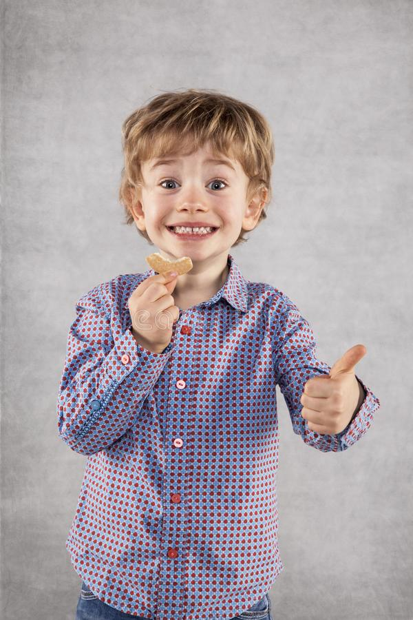Small businessman recommends tasty cakes for lunch, thumbs up stock image