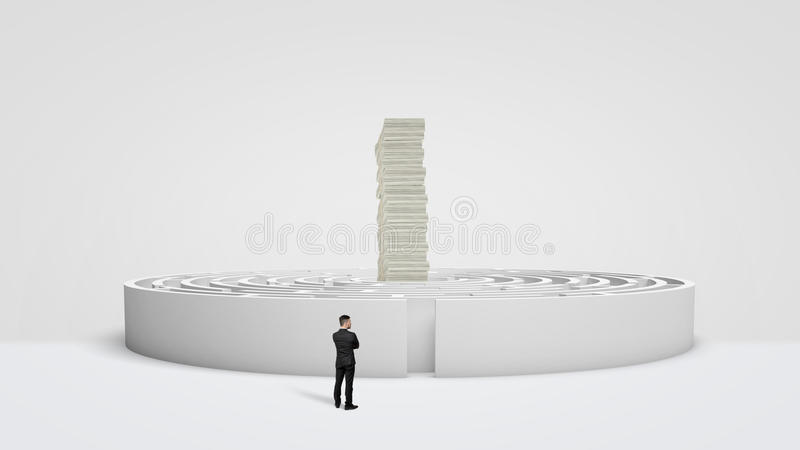 A small businessman standing in front of a white round maze where a huge stack of money bills towers at the center. Long way for money. Business rewards. Right stock photography