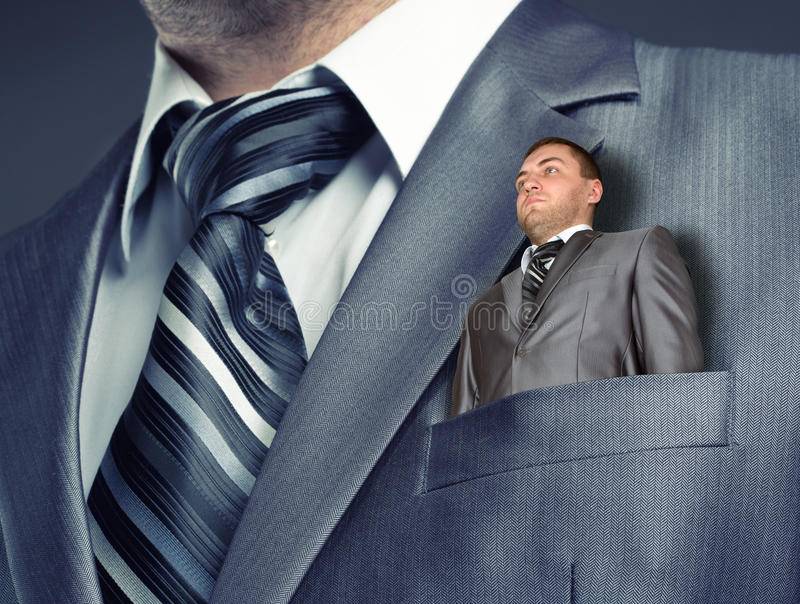Small businessman in suit pocket royalty free stock photography