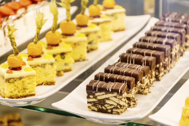 Small cakes in a luxury pastry shop. Different species of cakes in a pastry shop stock photo