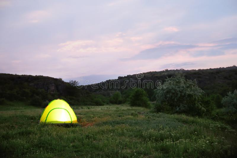 Small camping tent glowing outdoors royalty free stock image