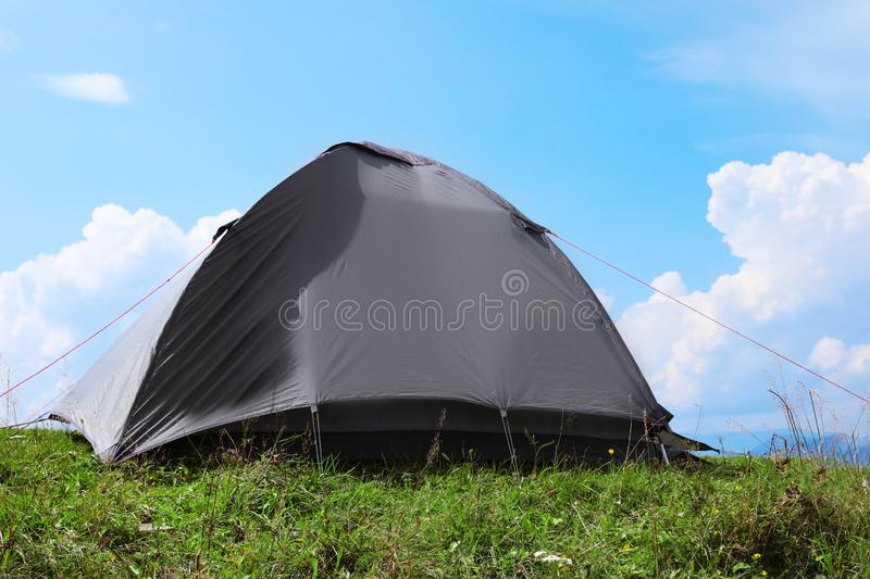 Small camping tent in mountains. On sunny day stock photo
