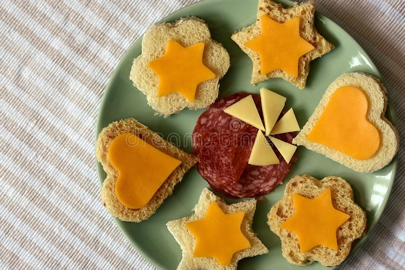 Kid`s party snacks, sandwiches on green plate stock photo