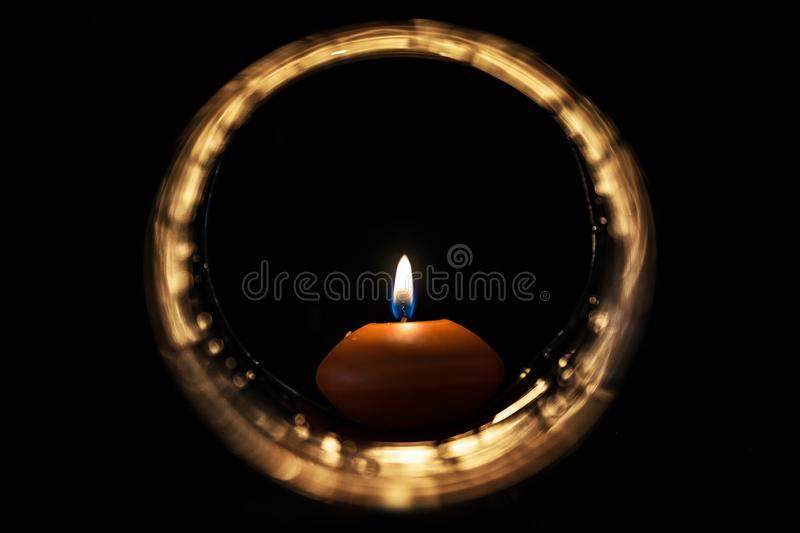 Candle inside light circle in the dark royalty free stock photo