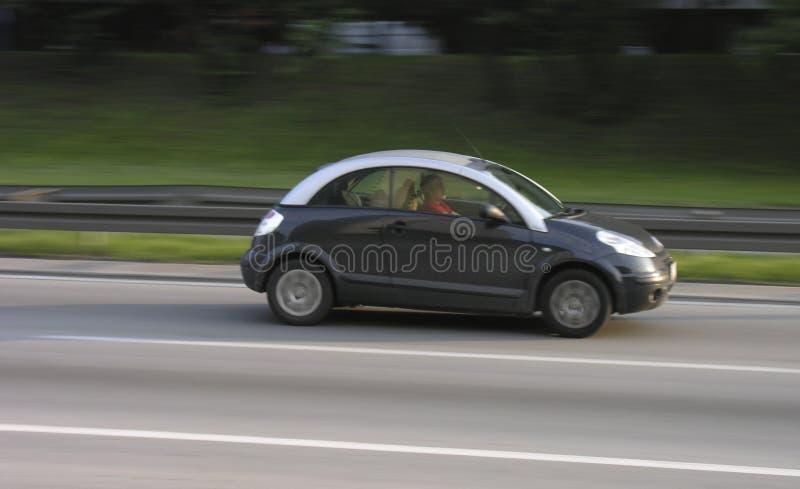 Small car speeding on a highway stock photo
