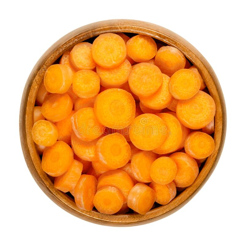 Small carrot slices, snack carrots cut into discs, in wooden bowl royalty free stock photos