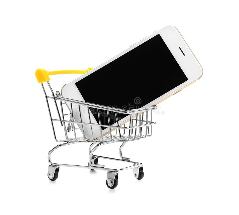 Small cart with mobile phone on white background. Shopping concept royalty free stock photos