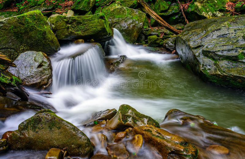 Small cascade on the river among bouders stock photos