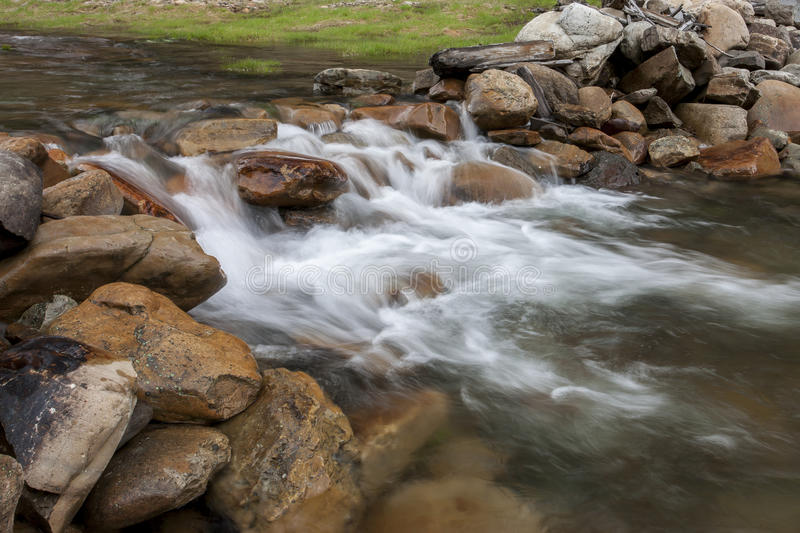 Small cascade in the stream. stock photography