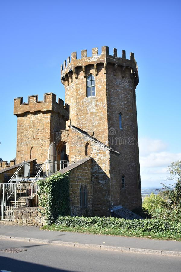 Small Castle in the countryside. A small little castle in a remote village out in the UK Countryside stock photo
