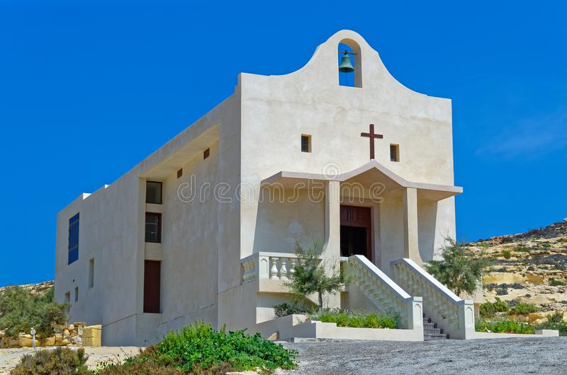 St Anne catholic Chapel near Dwejra, San Lawrenz. St Anne chapel - Small catholic church on a rocky mountain. This modern church building is located on the stock photo