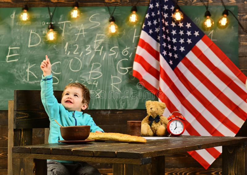 Small caucasian boy at American Flag on indeoendence day. stock photography
