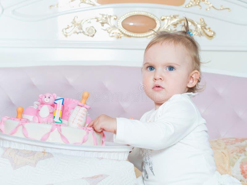 Small caucasian child girl on happy birthday with cake at home. Small caucasian child on happy birthday with cake at home royalty free stock photo
