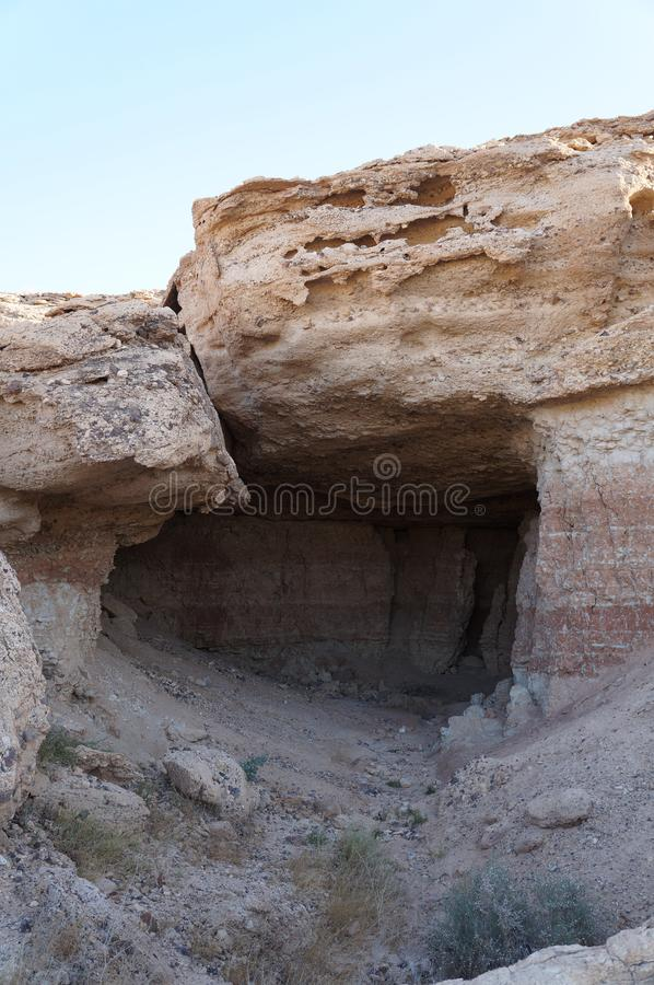 Small cave in the desert stock images