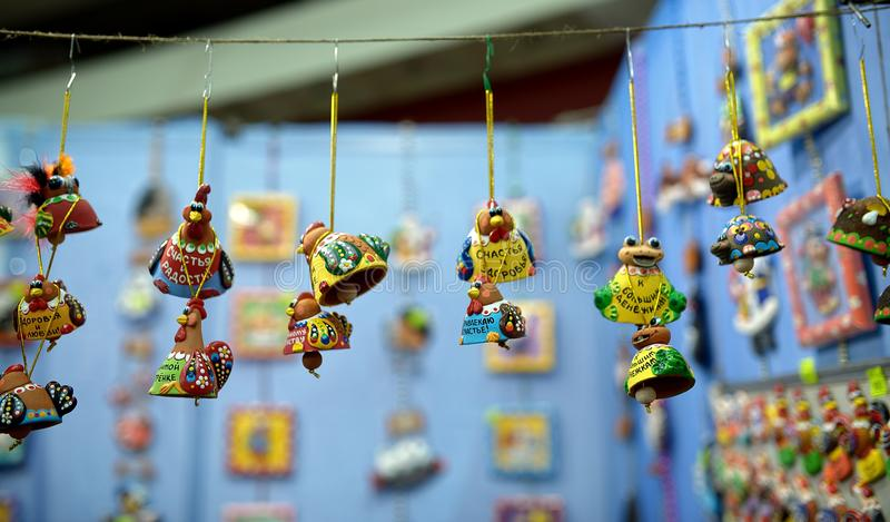 Small ceramic souvenirs in different shapes, sizes and styles.  stock images