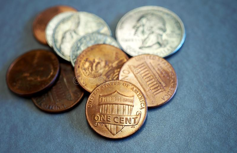 Small change in American coins. Small loose change in American cents and quarter coins royalty free stock photography