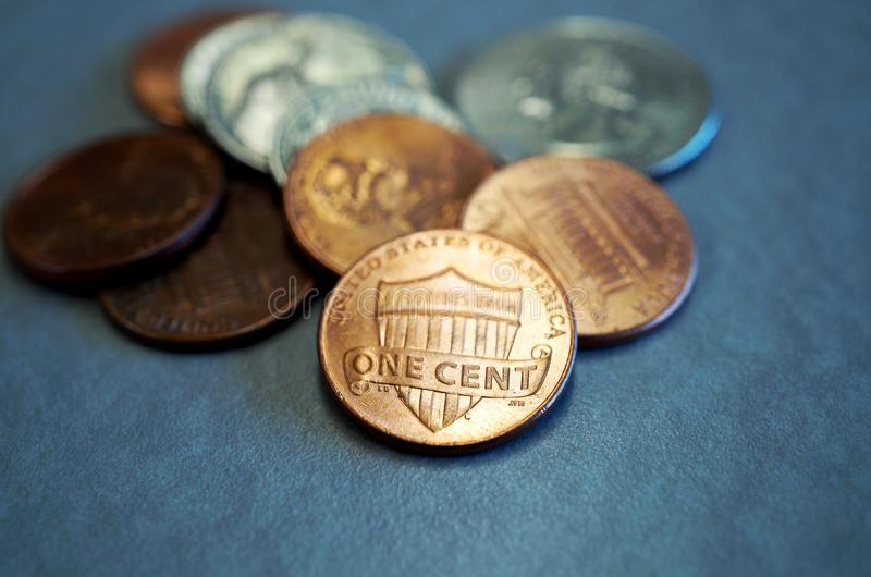 Small change in American coins. Small loose change in American cents and quarter coins stock photo