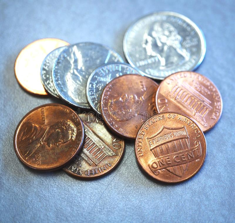 Small change in American coins. Small loose change in American cents and quarter coins royalty free stock photos