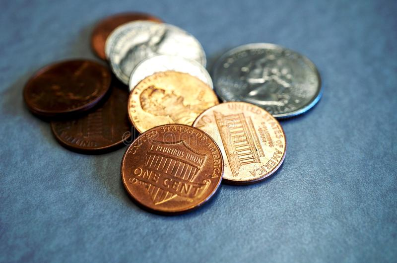 Small change in American coins. Small loose change in American cents and quarter coins royalty free stock photo