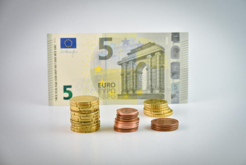 Small change euro money. Small change - stacks of euro coins and banknote royalty free stock image