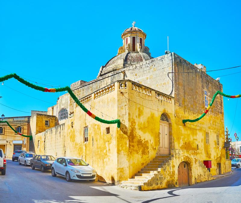 The small chapel, Siggiewi, Malta. The side wall of St John Baptist Church, located in historic district of Siggiewi, Malta royalty free stock photos