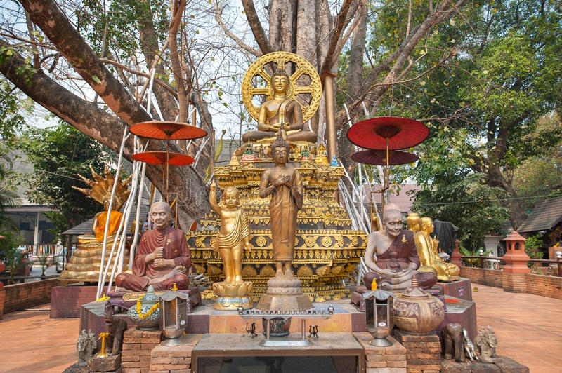 Small chedi surrounded by Buddha status at Wat Jed Yod, Chiang Mai, Thailand royalty free stock image