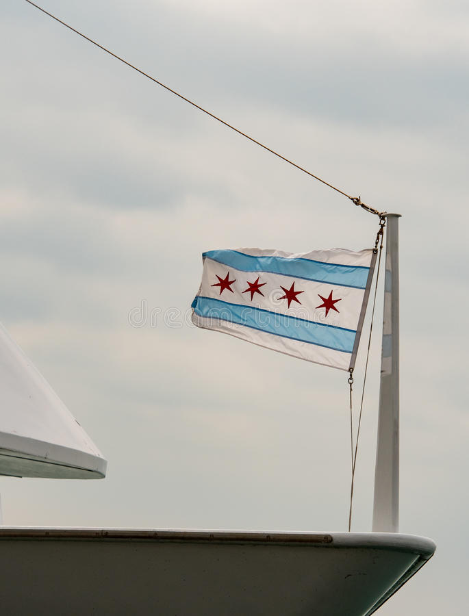 Small Chicago Flag on Boat Bow. On overcast day stock photo