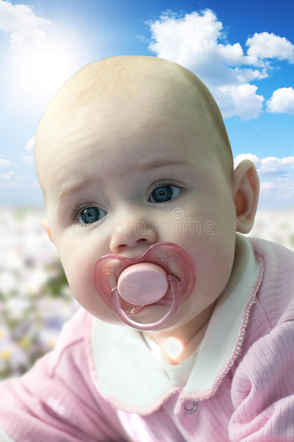 Small child at the age of 4 month stock photo