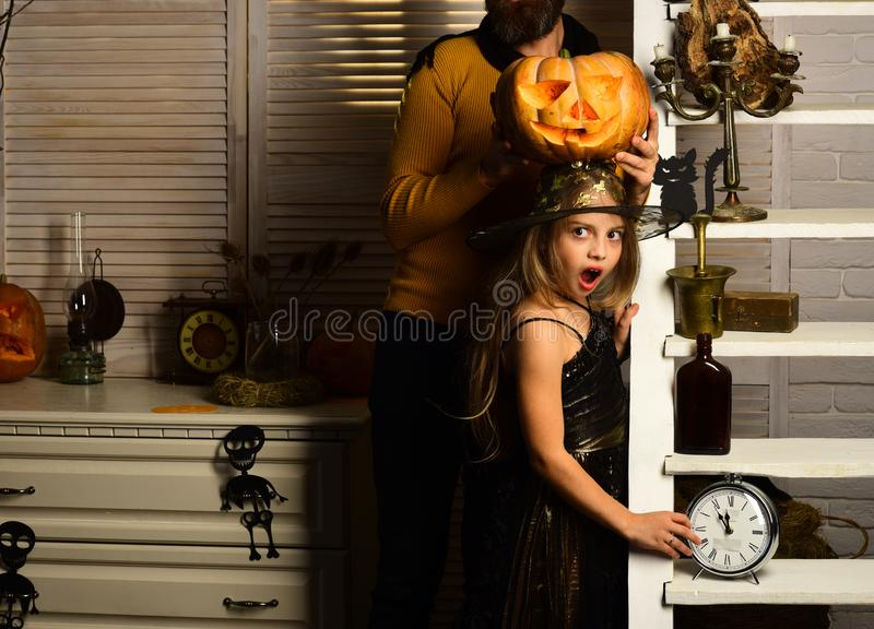 Small child with alarm clock on halloween. Small girl ready to celebrate halloween. Time to play. Perfectly on time stock images
