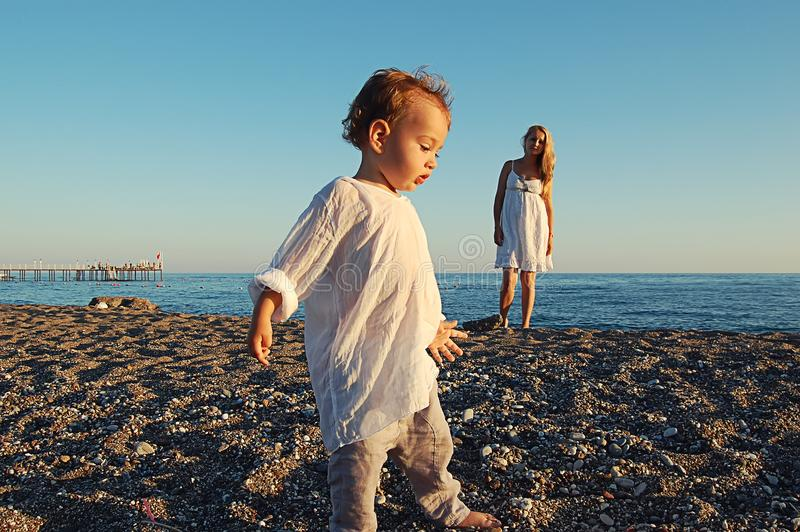 Small child on the beach on the sand in Side, Turkey stock image