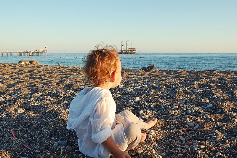 Small child on the beach on the sand in Side, Turkey royalty free stock photos
