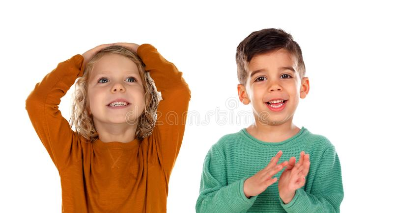 Small child covering his head and the other one aplauding royalty free stock photos