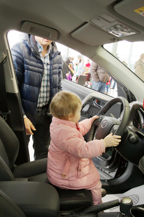 Download Small child drove the car editorial photography. Image of parent - 38753487