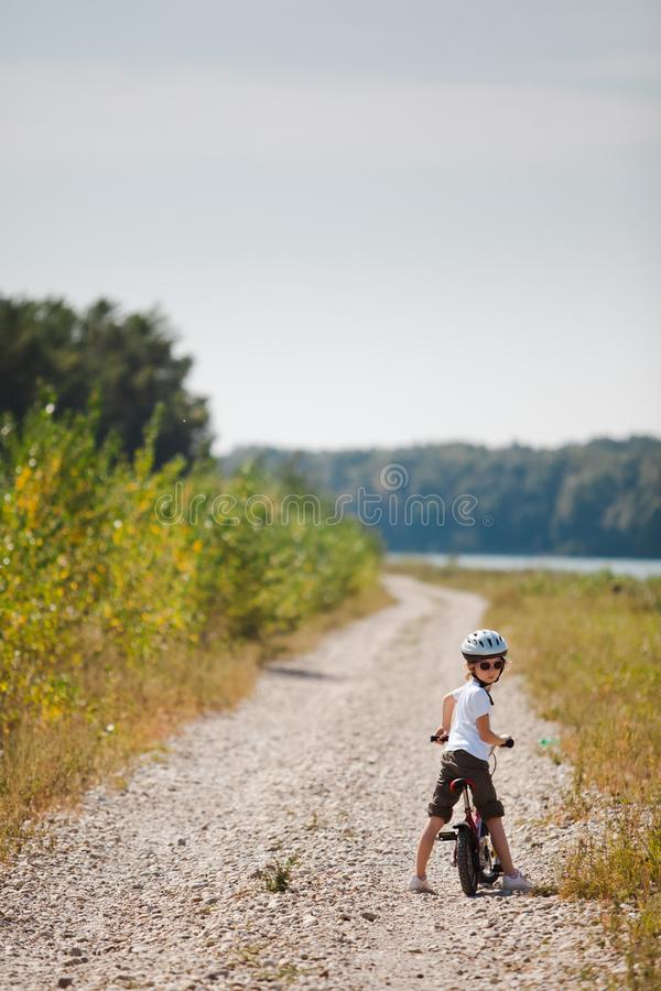 Small child with helmet learning ride a bicycle - Turns back royalty free stock photos