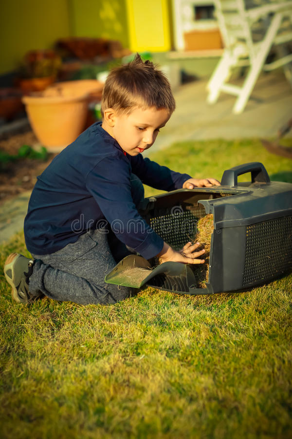 Small child helping in garden royalty free stock photography