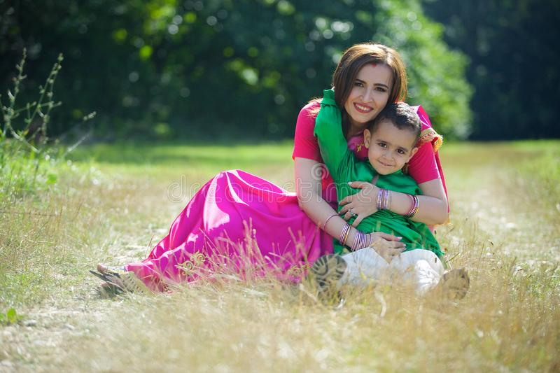 A small child and his mother in traditional Indian attire. royalty free stock images