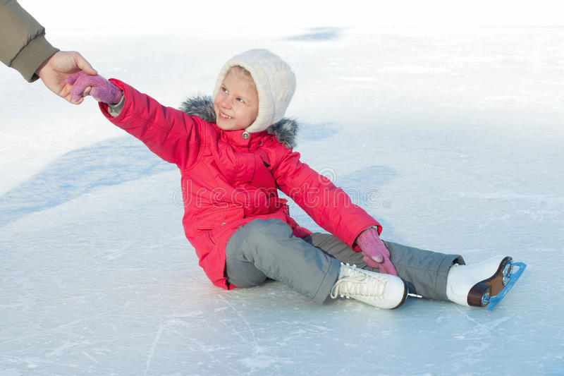 A child learns to skate stock photography