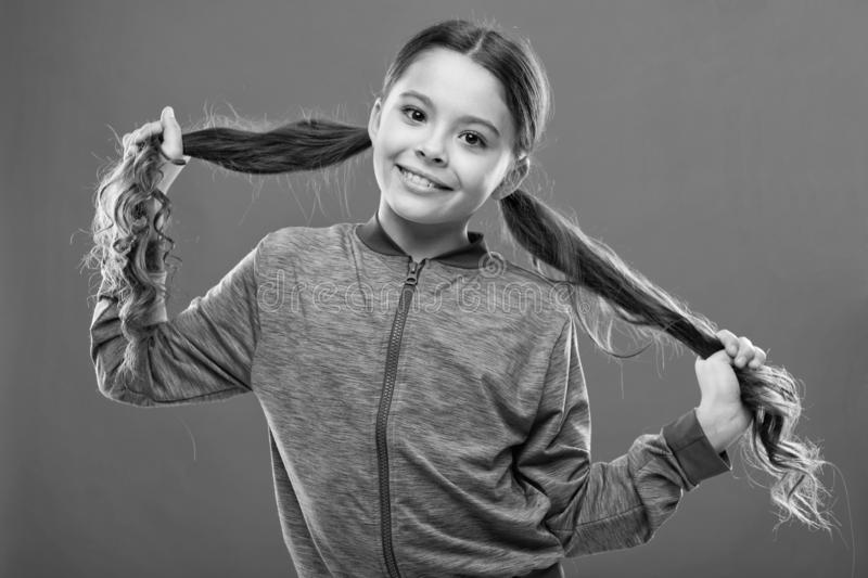 Small child long hair. Charming beauty. Girl active kid with long gorgeous hair. Strong and healthy hair concept. How to royalty free stock photography