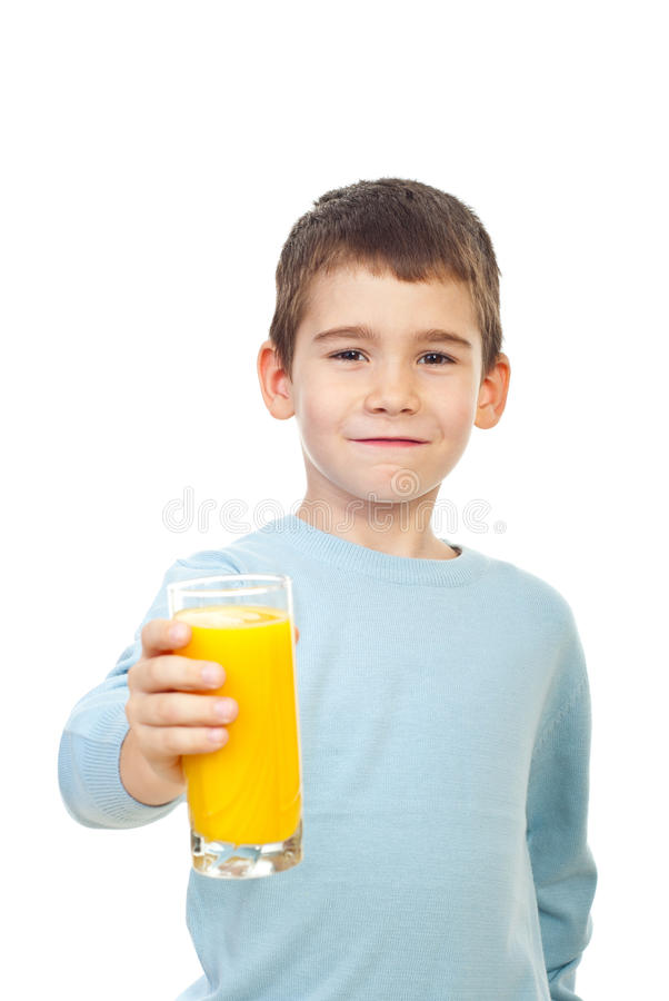 Small child offering orange juice royalty free stock photos