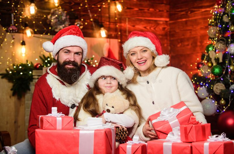 Small child and parents in santa hat. xmas gift boxes. Open present. merry christmas. Father and mother love daughter royalty free stock photography
