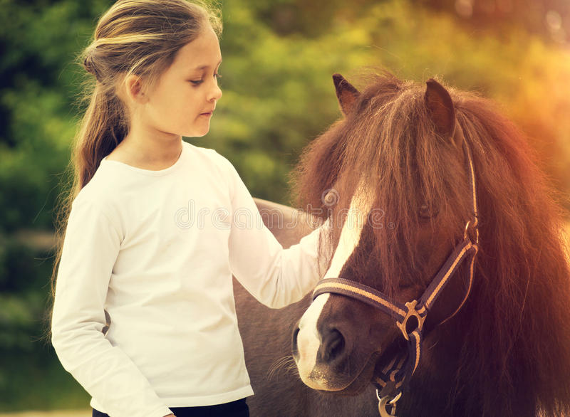 Small child and pony royalty free stock photos