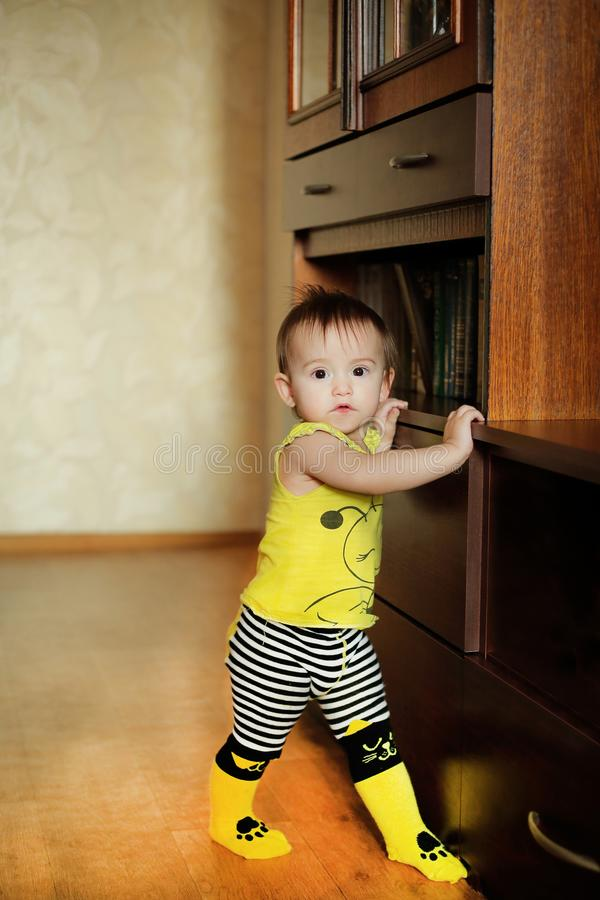 A small child posing in yellow clothes and with a picture of a bee stock photo