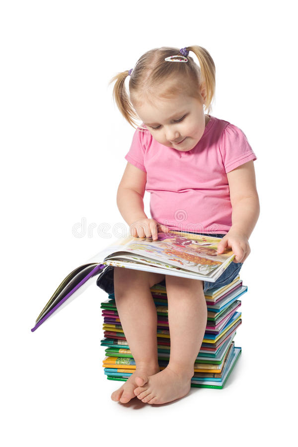 Small child reading a book. A small child reading a book stock image
