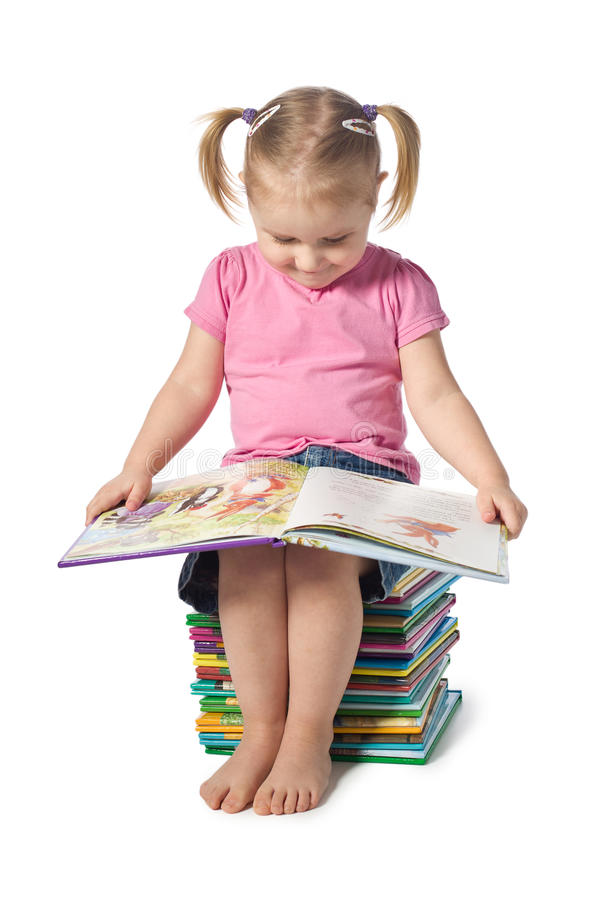 Download Small child reading a book stock image. Image of female - 17985557