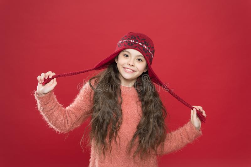 Small child ready for winter. kid fashion. Warm knitting tips. happy girl in earflap hat. holiday activity outdoor royalty free stock images