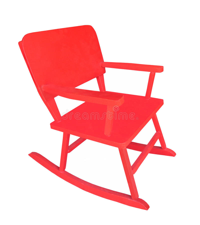 Small child's red rocking chair isolated. Small child's bright red wooden rocking chair with arms. Isolated on white royalty free stock photos