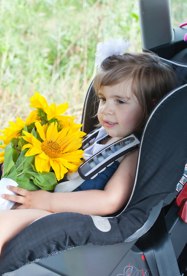 Small child sits in an automobile chair. Concept of safety of traffic royalty free stock photos